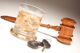 Glass of alcohol, car keys, and gavel